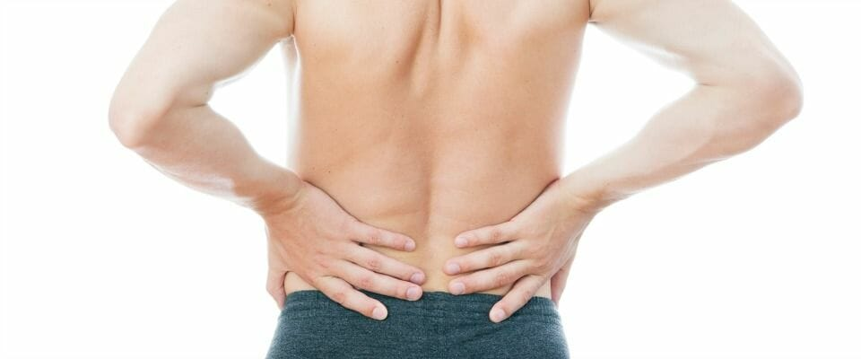 Man with back pain - lower back pain effect 40, 50 and 60 years olds who go to the gym