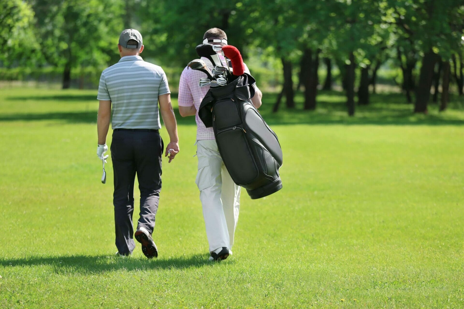 What can I do to ease my lower back pain when playing golf?